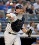 Jun 18, 2014; Bronx, NY, USA; New York Yankees catcher Brian McCann throws to first base during the MLB baseball game against the Toronto Blue Jays at Yankee Stadium. Mandatory Credit: Robert Deutsch-USA TODAY Sports
