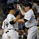 Jun 18, 2014; Bronx, NY, USA; New York Yankees catcher Brian McCann (right) celebrates with teammate Carlos Beltran after hitting a two-run home run in the 4th inning against the Toronto Blue Jays during the MLB baseball game at Yankee Stadium. Mandatory Credit: Robert Deutsch-USA TODAY Sports