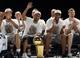 Jun 18, 2014; San Antonio, TX, USA; San Antonio Spurs guard Tony Parker (second from left)) waves to the crowd during NBA championship celebrations at Alamodome. Mandatory Credit: Soobum Im-USA TODAY Sports