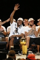 Jun 18, 2014; San Antonio, TX, USA; San Antonio Spurs forward Kawhi Leonard waves to the crowd during NBA championship celebrations at Alamodome. Mandatory Credit: Soobum Im-USA TODAY Sports