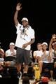 Jun 18, 2014; San Antonio, TX, USA; San Antonio Spurs forward Kawhi Leonard (2) waves to the crowd during NBA championship celebrations at Alamodome. Mandatory Credit: Soobum Im-USA TODAY Sports