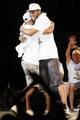 Jun 18, 2014; San Antonio, TX, USA; San Antonio Spurs forward Kawhi Leonard (right) hugs teammate Patrick Mills (left)  during NBA championship celebrations at Alamodome. Mandatory Credit: Soobum Im-USA TODAY Sports