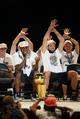 Jun 18, 2014; San Antonio, TX, USA; San Antonio Spurs forward Kawhi Leonard (left) laughs with teammate Marco Belinelli (right) as they celebrate NBA championship celebrations at Alamodome. Mandatory Credit: Soobum Im-USA TODAY Sports