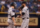 Jun 6, 2014; St. Petersburg, FL, USA; Seattle Mariners catcher John Buck (4) talks with relief pitcher Tom Wilhelmsen (54) against the Tampa Bay Rays at Tropicana Field. Tampa Bay Rays defeated the Seattle Mariners 4-0. Mandatory Credit: Kim Klement-USA TODAY Sports