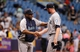 Jun 8, 2014; St. Petersburg, FL, USA; Seattle Mariners manager Lloyd McClendon (23) and relief pitcher Charlie Furbush (41) hand shake after they beat the Tampa Bay Rays at Tropicana Field. Seattle Mariners defeated the Tampa Bay Rays 5-0. Mandatory Credit: Kim Klement-USA TODAY Sports