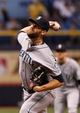 Jun 6, 2014; St. Petersburg, FL, USA; Seattle Mariners relief pitcher Tom Wilhelmsen (54) throws a pitch against the Tampa Bay Rays at Tropicana Field. Tampa Bay Rays defeated the Seattle Mariners 4-0. Mandatory Credit: Kim Klement-USA TODAY Sports