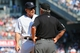 Jun 22, 2014; Bronx, NY, USA;  New York Yankees manager Joe Girardi (28) argues a call with umpire Tom Hallion (20) during the eighth inning against the Baltimore Orioles at Yankee Stadium. Baltimore Orioles won 8-0. Mandatory Credit: Anthony Gruppuso-USA TODAY Sports