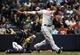 Jun 23, 2014; Milwaukee, WI, USA;  Washington Nationals first baseman Adam LaRoche (25) hits a 3-run home run in the third inning as Milwaukee Brewers catcher Jonathan Lucroy (20) watches at Miller Park. Mandatory Credit: Benny Sieu-USA TODAY Sports