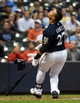 Jun 23, 2014; Milwaukee, WI, USA;  Milwaukee Brewers center fielder Carlos Gomez (27) loses his helmet while swinging at a pitch in the ninth inning against the Washington Nationals at Miller Park. Mandatory Credit: Benny Sieu-USA TODAY Sports
