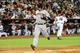 Jun 24, 2014; Phoenix, AZ, USA; Cleveland Indians catcher Yan Gomes (10) scores during the second inning against the Arizona Diamondbacks at Chase Field. Mandatory Credit: Matt Kartozian-USA TODAY Sports