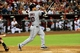 Jun 24, 2014; Phoenix, AZ, USA; Cleveland Indians catcher Yan Gomes (10) hits a sacrifice fly allowing left fielder Michael Brantley (23) to score during the third inning against the Arizona Diamondbacks at Chase Field. Mandatory Credit: Matt Kartozian-USA TODAY Sports