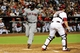 Jun 24, 2014; Phoenix, AZ, USA; Cleveland Indians third baseman Carlos Santana (41) scores as Arizona Diamondbacks catcher Miguel Montero (26) waits for the ball during the second inning at Chase Field. Mandatory Credit: Matt Kartozian-USA TODAY Sports