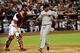Jun 24, 2014; Phoenix, AZ, USA; Cleveland Indians left fielder Michael Brantley (23) scores as Arizona Diamondbacks catcher Miguel Montero (26) looks on during the third inning at Chase Field. Mandatory Credit: Matt Kartozian-USA TODAY Sports