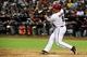 Jun 24, 2014; Phoenix, AZ, USA; Arizona Diamondbacks right fielder Gerardo Parra (8) hits a single during the sixth inning against the Cleveland Indians at Chase Field. Mandatory Credit: Matt Kartozian-USA TODAY Sports