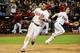Jun 24, 2014; Phoenix, AZ, USA; Arizona Diamondbacks right fielder Gerardo Parra (8) scores on a hit by second baseman Aaron Hill (not pictured) to beat the Cleveland Indians 9-8 in the fourteenth inning at Chase Field. Mandatory Credit: Matt Kartozian-USA TODAY Sports