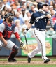 Jun 25, 2014; Milwaukee, WI, USA;  Milwaukee Brewers second baseman Scooter Gennett (2) hits a grand slam home run in the second inning as Washington Nationals catcher Sandy Leon (41) watches at Miller Park. Mandatory Credit: Benny Sieu-USA TODAY Sports
