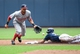Jun 25, 2014; Milwaukee, WI, USA;  Milwaukee Brewers center fielder Carlos Gomez (27) steals second base as Washington Nationals shortstop Ian Desmond (20) fields the throw in the first inning at Miller Park. Mandatory Credit: Benny Sieu-USA TODAY Sports