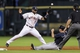 Jun 25, 2014; Houston, TX, USA; Atlanta Braves second baseman Tommy La Stella (7) slides safely with a stolen base as Houston Astros shortstop Jonathan Villar (2) attempts to field the throw during the fourth inning at Minute Maid Park. Mandatory Credit: Troy Taormina-USA TODAY Sports