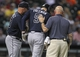 Jun 25, 2014; Houston, TX, USA; Atlanta Braves first baseman Freddie Freeman (5) is escorted off the field after being hit by a pitch during the eighth inning against the Houston Astros at Minute Maid Park. Mandatory Credit: Troy Taormina-USA TODAY Sports