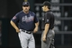 Jun 25, 2014; Houston, TX, USA; Atlanta Braves manager Fredi Gonzalez (33) discusses a call with second base umpire James Hoye (right) during the eighth inning against the Houston Astros at Minute Maid Park. Mandatory Credit: Troy Taormina-USA TODAY Sports