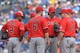 Jun 29, 2014; Kansas City, MO, USA; Los Angeles Angels manager Mike Scioscia (14) talks with his infield against the Kansas City Royals during the ninth inning at Kauffman Stadium. Mandatory Credit: Peter G. Aiken-USA TODAY Sports