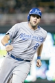 Jun 30, 2014; Minneapolis, MN, USA; Kansas City Royals third baseman Mike Moustakas (8) rounds third in the eighth inning against the Minnesota Twins at Target Field. The Kansas City Royals win 6-1. Mandatory Credit: Brad Rempel-USA TODAY Sports