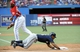 Jul 1, 2014; Toronto, Ontario, CAN; Milwaukee Brewers left fielder Khris Davis dives into first base as Toronto Blue Jays first baseman Edwin Encarcion looks on during the game at Rogers Centre. Mandatory Credit: Peter Llewellyn-USA TODAY Sports