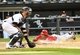 Jul 1, 2014; Chicago, IL, USA; Los Angeles Angels third baseman John McDonald (8) slides safely in front of the tag of Chicago White Sox catcher Tyler Flowers (21) during the eighth inning at U.S Cellular Field. Los Angeles Angels defeat the Chicago White Sox 8-4. Mandatory Credit: Mike DiNovo-USA TODAY Sports