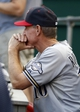 Jul 4, 2014; Cincinnati, OH, USA; Milwaukee Brewers manager Ron Roenicke watches from the dugout during game against the Cincinnati Reds at Great American Ball Park. Mandatory Credit: David Kohl-USA TODAY Sports