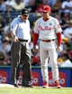 Jul 5, 2014; Pittsburgh, PA, USA; First base umpire Dale Scott (L) talks with Philadelphia Phillies manager Ryne Sandberg (23) about a challenge call against the Pittsburgh Pirates during the fifth inning at PNC Park. The Pirates won 3-2. Mandatory Credit: Charles LeClaire-USA TODAY Sports