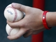 Jul 5, 2014; Cincinnati, OH, USA; Cincinnati Reds ball bat boy holds new game balls during a game with the Milwaukee Brewers at Great American Ball Park. The Brewers won 1-0. Mandatory Credit: David Kohl-USA TODAY Sports