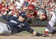 Jul 5, 2014; Cincinnati, OH, USA; Milwaukee Brewers third baseman Aramis Ramirez (16) is tagged out at home by Cincinnati Reds catcher Devin Mesoraco, right, during the sixth inning at Great American Ball Park. The Brewers won 1-0. Mandatory Credit: David Kohl-USA TODAY Sports