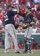 Jul 5, 2014; Cincinnati, OH, USA; Milwaukee Brewers starting pitcher Matt Garza (22) is congratulated by catcher Jonathan Lucroy, right, after Garza pitched a complete game two-hit shutout against the Cincinnati Reds at Great American Ball Park. The Brewers won 1-0. Mandatory Credit: David Kohl-USA TODAY Sports