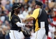Jul 5, 2014; Pittsburgh, PA, USA; Pittsburgh Pirates center fielder Andrew McCutchen (L) shakes hands with Pittsburgh Pirates manager Clint Hurdle (R) after defeating the Philadelphia Phillies at PNC Park. The Pirates won 3-2. Mandatory Credit: Charles LeClaire-USA TODAY Sports