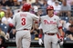 Jul 5, 2014; Pittsburgh, PA, USA; Philadelphia Phillies right fielder Marlon Byrd (3) is greeted at home plate by third baseman Cody Asche (R) after Byrd hit a solo home run against the Pittsburgh Pirates during the ninth inning at PNC Park. The Pirates won 3-2. Mandatory Credit: Charles LeClaire-USA TODAY Sports