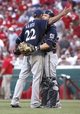 Jul 5, 2014; Cincinnati, OH, USA; Milwaukee Brewers starting pitcher Matt Garza, left, is congratulated by catcher Jonathan Lucroy, right,  after Garza pitched a complete game two-hit shutout against the Cincinnati Reds at Great American Ball Park. The Brewers won 1-0. Mandatory Credit: David Kohl-USA TODAY Sports