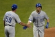 Jul 5, 2014; Cleveland, OH, USA; Kansas City Royals third baseman Danny Valencia (19) celebrates his solo home run with third base coach Mike Jirschele (59) in the seventh inning against the Cleveland Indians at Progressive Field. Mandatory Credit: David Richard-USA TODAY Sports