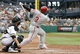 Jul 6, 2014; Pittsburgh, PA, USA; Philadelphia Phillies right fielder Marlon Byrd (3) hits a solo home run against the Pittsburgh Pirates during the seventh inning at PNC Park. The Pirates won 6-2. Mandatory Credit: Charles LeClaire-USA TODAY Sports