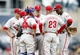 Jul 6, 2014; Pittsburgh, PA, USA; Philadelphia Phillies manager Ryne Sandberg (23) talks with relief pitcher Jake Diekman (middle) and the Phillies infield against the Pittsburgh Pirates during the eighth inning at PNC Park. The Pirates won 6-2. Mandatory Credit: Charles LeClaire-USA TODAY Sports