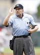 Jul 6, 2014; Pittsburgh, PA, USA; Home plate umpire Dale Scott (5) gestures for a Philadelphia Phillies pitching change against the Pittsburgh Pirates during the eighth inning at PNC Park. The Pirates won 6-2. Mandatory Credit: Charles LeClaire-USA TODAY Sports
