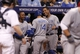 Jul 7, 2014; St. Petersburg, FL, USA; Kansas City Royals second baseman Omar Infante (14) is congratulated by catcher Salvador Perez (13) and teammates after he scores during the eighth inning against the Tampa Bay Rays at Tropicana Field. Mandatory Credit: Kim Klement-USA TODAY Sports