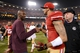 December 23, 2013; San Francisco, CA, USA; San Francisco 49ers former wide receiver Terrell Owens (left) shakes hands with quarterback Colin Kaepernick (7) after the final regular season game at Candlestick Park against the Atlanta Falcons. The 49ers defeated the Falcons 34-24. Mandatory Credit: Kyle Terada-USA TODAY Sports