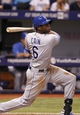 Jul 8, 2014; St. Petersburg, FL, USA; Kansas City Royals center fielder Lorenzo Cain (6) triples during the seventh inning against the Tampa Bay Rays at Tropicana Field. Mandatory Credit: Kim Klement-USA TODAY Sports