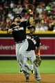 Jul 8, 2014; Phoenix, AZ, USA; Miami Marlins third baseman Casey McGehee (9) catches the ball as shortstop Adeiny Hechavarria (3) looks on during the second inning against the Arizona Diamondbacks at Chase Field. Mandatory Credit: Matt Kartozian-USA TODAY Sports