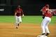 Jul 9, 2014; Phoenix, AZ, USA; Arizona Diamondbacks shortstop Didi Gregorius (1) throws to first baseman Paul Goldschmidt (44) during the eighth inning against the Miami Marlins at Chase Field. Mandatory Credit: Matt Kartozian-USA TODAY Sports