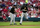 Jul 9, 2014; St. Louis, MO, USA; Pittsburgh Pirates second baseman Neil Walker (18) is congratulated by third base coach Nick Leyva (16) after hitting a solo home run off of St. Louis Cardinals starting pitcher Lance Lynn (not pictured) during the second inning at Busch Stadium. Mandatory Credit: Jeff Curry-USA TODAY Sports