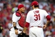 Jul 9, 2014; St. Louis, MO, USA; St. Louis Cardinals catcher Yadier Molina (4) talks with starting pitcher Lance Lynn (31) during the second inning against the Pittsburgh Pirates at Busch Stadium. Mandatory Credit: Jeff Curry-USA TODAY Sports