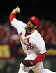 Jul 10, 2014; St. Louis, MO, USA; St. Louis Cardinals relief pitcher Jason Motte (30) throws to a Pittsburgh Pirates batter during the ninth inning at Busch Stadium. Pirates defeated the Cardinals 9-1. Mandatory Credit: Jeff Curry-USA TODAY Sports