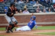 Jul 11, 2014; New York, NY, USA;  New York Mets shortstop Ruben Tejada (11) slides safe as Miami Marlins catcher Jarrod Saltalamacchia (39) waits for the ball during the second inning at Citi Field. Mandatory Credit: Anthony Gruppuso-USA TODAY Sports
