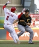 Jul 11, 2014; Cincinnati, OH, USA; Cincinnati Reds center fielder Billy Hamilton (6) escapes the tag from Pittsburgh Pirates first baseman Gaby Sanchez (17) for a bunt single in the first inning at Great American Ball Park. Mandatory Credit: David Kohl-USA TODAY Sports